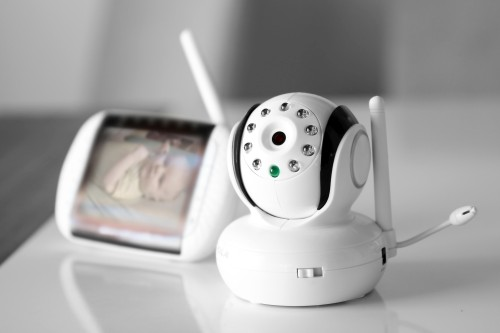 A Security Camera monitoring a baby in a cradle