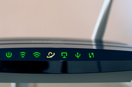 A Wi-Fi router sitting on a desk